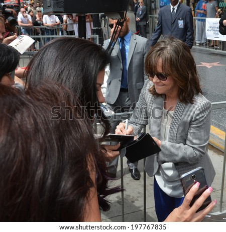 HOLLYWOOD - MAY 5: Sally Field is signing autograps on her star celebration on 5 May in 2014 at the Walk of Fame in Hollywood - stock photo