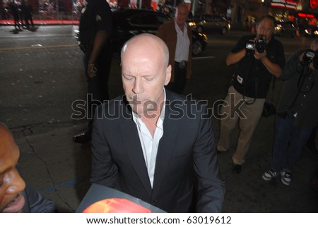 HOLLYWOOD, OCTOBER 11: Actor Bruce Willis arrives at a special screening of Summit Entertainment's 'RED' at Grauman's Chinese Theatre on October 11, 2010 in Hollywood, California.
