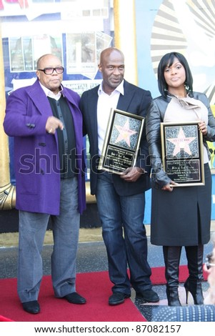 HOLLYWOOD - OCTOBER 20: BeBe and CeCe Winans and Quincy Jones (L) at the Walk of Fame Ceremony where the Winans received a star on October 20, 2011 in Hollywood, CA. - stock photo