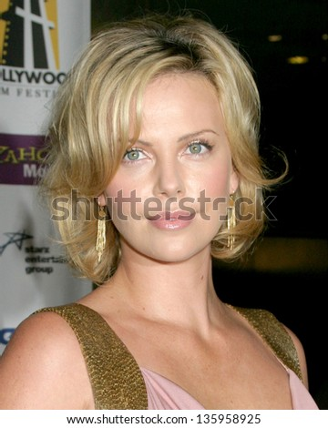 HOLLYWOOD - OCTOBER 24: Charlize Theron participates at Hollywood Film Festival Gala in Beverly Hilton Hotel October 24, 2005 in Los Angeles, CA. - stock photo