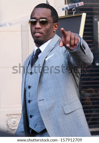 "HOLLYWOOD-OCTOBER 10, 2013: Sean ""Puffy"" Combs attends Hollywood Walk of Fame ceremony for Kenneth ""Babyface"" Edmonds October 10, 2013 Hollywood, CA. - stock photo"