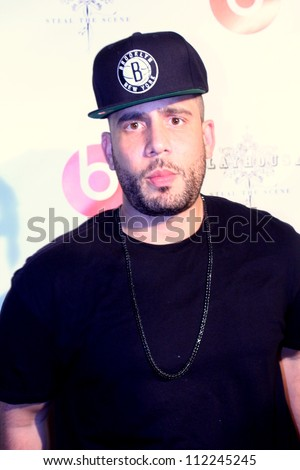 HOLLYWOOD - SEPTEMBER 6, 2012: Dj Drama walks the red carpet for Beats by Dr Dre & Lil Wayne VMA after party the Playhouse Nightclub September 6, 2012 Hollywood, CA. - stock photo