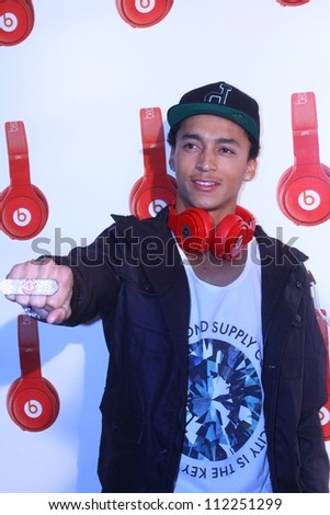 HOLLYWOOD - SEPTEMBER 6, 2012: Nyjah Johnson walks the red carpet for Beats By Dr Dre & Lil Wayne VMA After Party at the Playhouse Nightclub September 6, 2012 Hollywood, CA. - stock photo