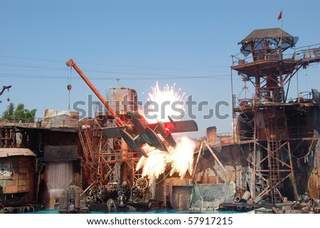 HOLLYWOOD - SEPTEMBER 15: Seaplane exploded into the scene in the live stunt show called Waterworld on 15 September in 2008 in the Universal Studios Hollywood. - stock photo