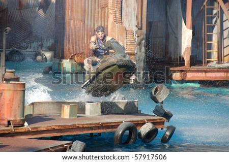HOLLYWOOD - SEPTEMBER 15: Stuntman Brian Collins is in action in the live stunt show called Waterworld on 15 September in 2008 in the Universal Studios Hollywood.