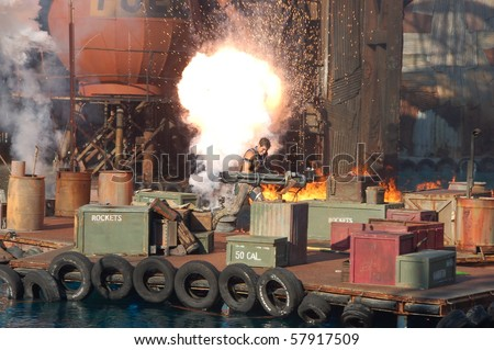 HOLLYWOOD - SEPTEMBER 15: Stuntman Brian Collins tries to escape from the explosion in the live stunt show called Waterworld on 15 September in 2008 in the Universal Studios Hollywood. - stock photo