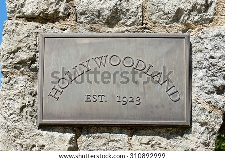 Hollywoodland Metal Sign with an establish date of 1923, Metal sign on a stone wall gives date for landmark,Image was taken 3/29/15, and Image was taken off of Beachwood Drive in Hollywood, California - stock photo