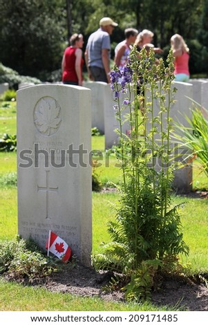 HOLTEN, THE NETHERLANDS, EUROPE - MAY 5th 2014: Visitors of the Canadian War Cemetary paying their respect to victims of the Second World War - stock photo