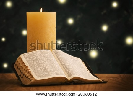 Holy Bible in front of Christmas tree - stock photo