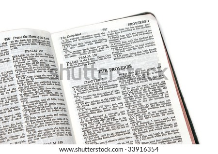 holy bible open to the book of  proverbs , on white background