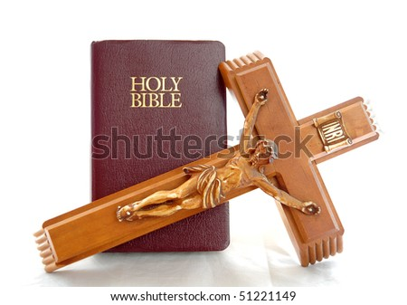 Holy Bible with a red leather cover isolated on a white background with cross - stock photo