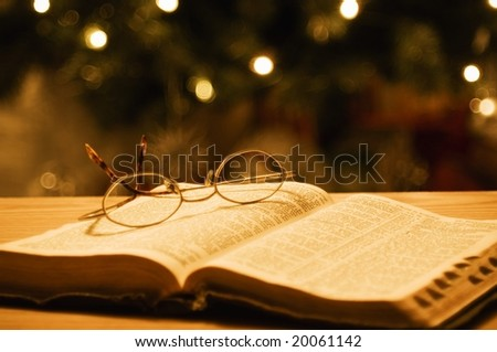 holy bible with eyeglasses - stock photo