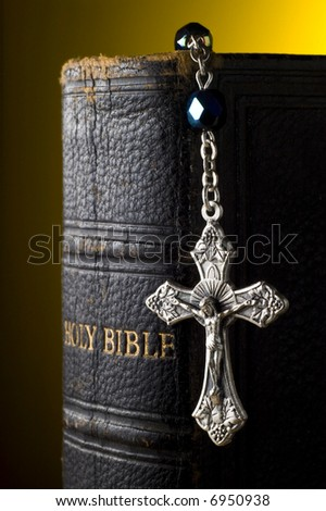 Holy Bible with rosary - stock photo