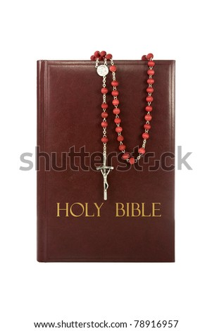 holy bible with rosary isolated on white background. - stock photo