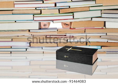 Holy Book against the backdrop of numerous books and people. - stock photo