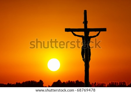 Holy cross at sunset - stock photo