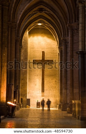 Holy cross at the end of a corridor of Chartres Cathedral, France - stock photo