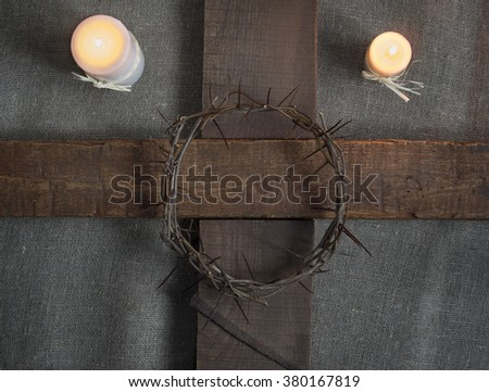 Holy Cross, crown of thorns, candles on a burlap background - stock photo