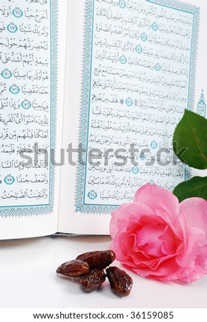 Holy Islam book, some dates and rose - stock photo