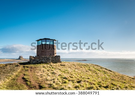 Holy Island Lookout Tower / The former Coastguards Lookout Tower on Holy Island off the Northumberland coastline - stock photo