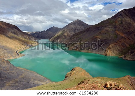 Holy lake in Tibet from Simi-la pass - stock photo