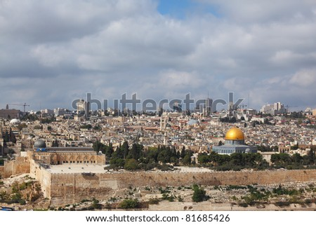 Holy Land. Black Dome of the Rock mosque - the Al-Aqsa Mosque. In the background - modern skyscrapers and cranes newly - stock photo