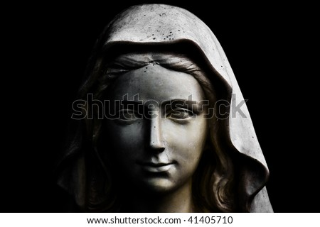 Holy Mary statue portrait isolated on black - stock photo