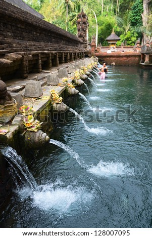 Holy spring water in Tirta Empul temple, Bali, Indonesia - stock photo