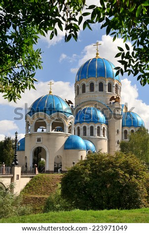 Holy Trinity Cathedral in Orekhovo-Borisovo framed by trees. The Neo-Bysintine style Church built in 2001-04 at the Borisovo Ponds is a metochion of the Patriarch of Moscow on Kashirskoe highway. - stock photo