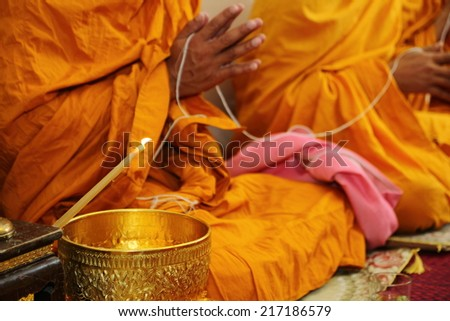 Holy water, the monks and religious rituals in buddhist ceremony. - stock photo