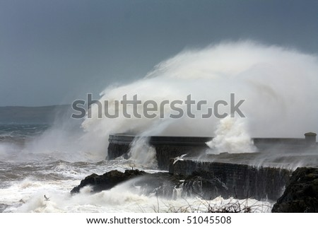 Holyhead breakwater and harbour in stormy weather with waves crashing over the walls Isle of Anglesey North wales