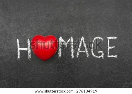 homage word handwritten on chalkboard with heart symbol instead of O