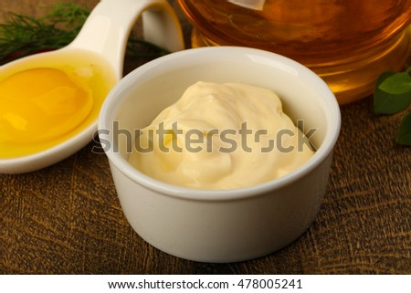 Homamade Mayonnaise with egg and oil in bottle