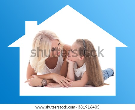 home and family concept - mother talking with her little daughter lying on the floor
