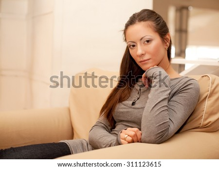 home and happiness concept - smiling woman at home