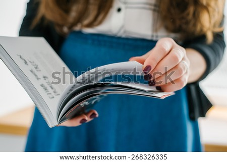 home and leasure concept - smiling woman reading magazine at home - stock photo