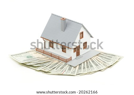 Home and Money Isolated on a White Background - stock photo