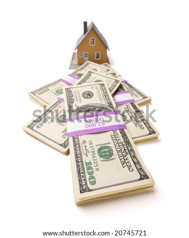 Home and Stacks of Money Isolated on a White Background - stock photo