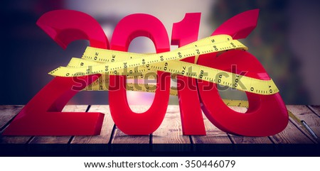 Home at christmas time against 2016 with measuring tape - stock photo