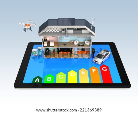 Home automation concept. Home appliances energy monitoring by tablet. Energy efficiency rating chart available. - stock photo