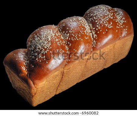 Home-backed panetone in traditional form on pure black background - stock photo