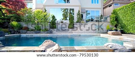 Home Backyard Exterior Panorama with Pool - stock photo