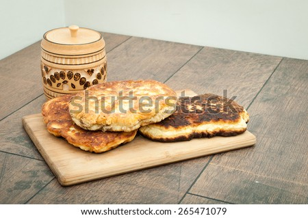 home-baked bread on a wooden board - stock photo