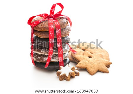home baked christmas cookies on white with red ribbon - stock photo