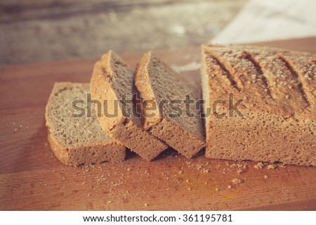 Home baked gluten free bread on wooden board - stock photo