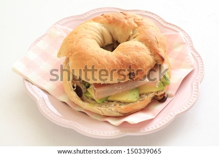 home bakery, ham and avocado bagel sandwich - stock photo