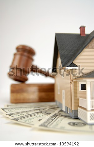 Home being sold at an auction; shallow depth of field - stock photo