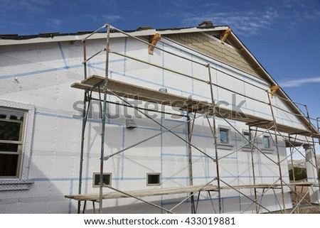 Home building industry house scaffolding for stucco and insulation foam
