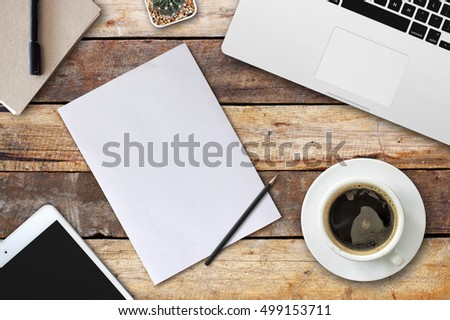 home business desk with communication device. empty space for text. selective focus and over light