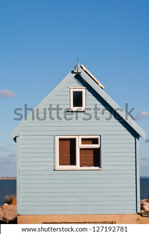 home by the sea - stock photo